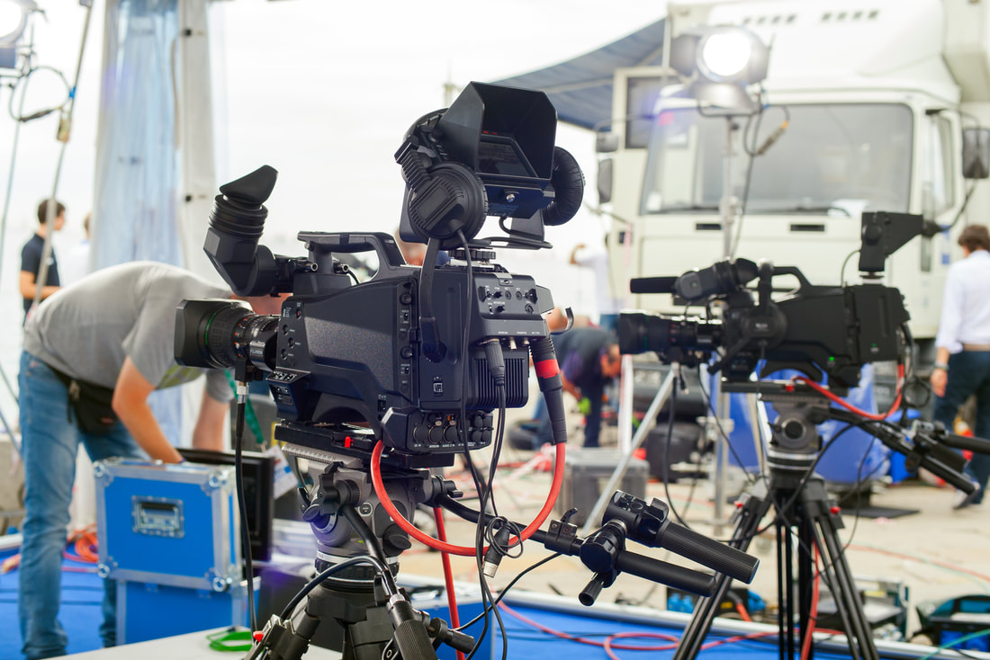 Picture of a multi-angle video shoot using multiple cameras postitioned at different points to film the same event from different perspectives.
