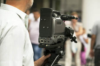 Picture of a video producer setting up for a public information video shoot.